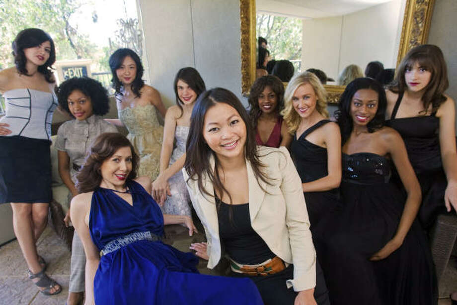 Houston designer Chloe Dao poses with her models at Hotel Zaza, where she presented her fall collection at the national convention of the American Association of Sunday and Features Editors. Photo: Bill Olive, For The Chronicle