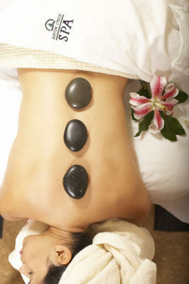 Hot stone massages are among the treatments offered at Barton Creek Resort & Spa near Austin. Photo: Barton Creek Resort & Spa