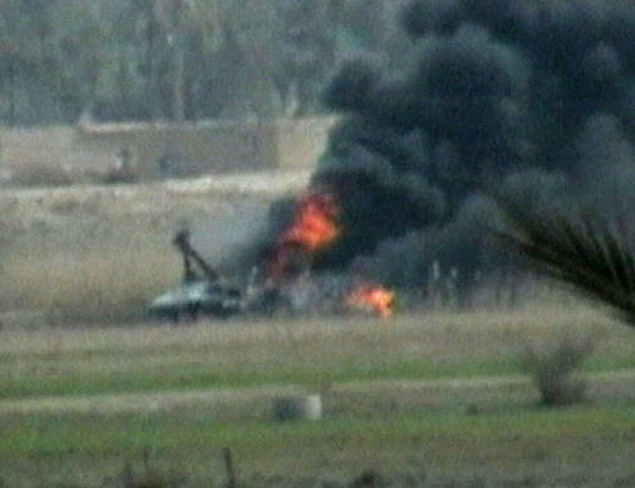 In this image made from video broadcast by AP Television News today, smoke and flame rise from the crash site of a U.S. military CH-46 Sea Knight helicopter which went down about 30 kilometers (20 miles) northwest of Baghdad. Photo: AP