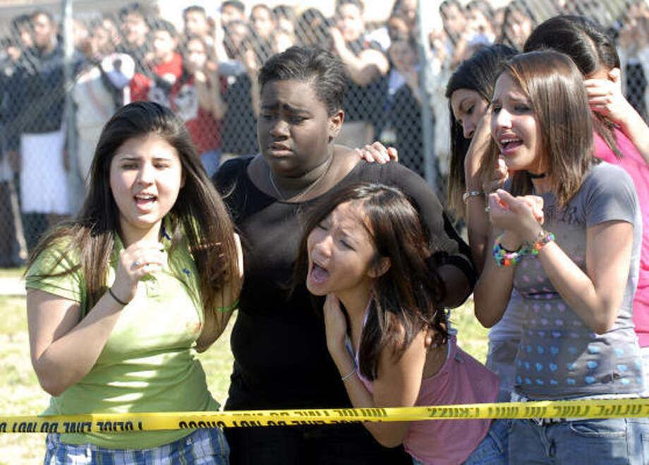 Student actors Mara Salazar 19, left; Lauren Bourgeois 17; An Nguyen, 18; and Ashley Vasquez, 16 react to scene of Shattered Dreams re-enactment held at Chavez High School. Photo: Kim Christensen, For The Chronicle