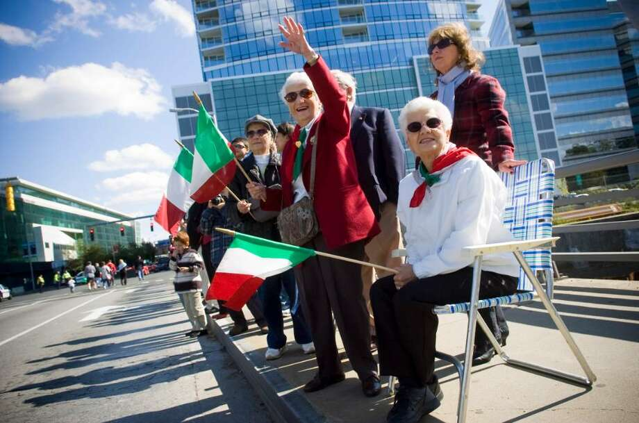 From left, Rose Santorella, Claudia Toscano, Delia Truglia and Ana Truglia, wave to friends marching in the annual Columbus Day Parade in Stamford, Conn. on Sunday, Oct. 11, 2009. Photo: Chris Preovolos / Stamford Advocate