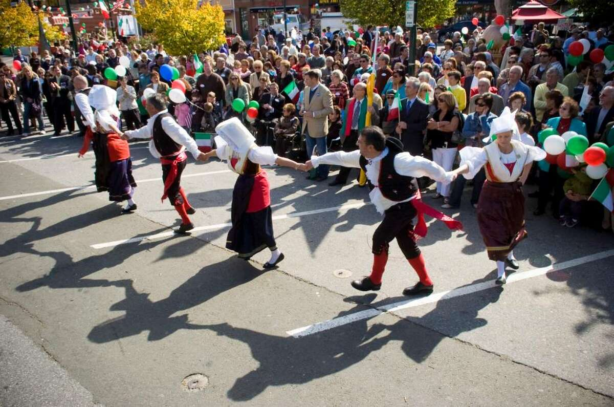 Minturnese dancers perform for the crowd during the annual Columbus Day Parade in Stamford, Conn. on Sunday, Oct. 11, 2009.