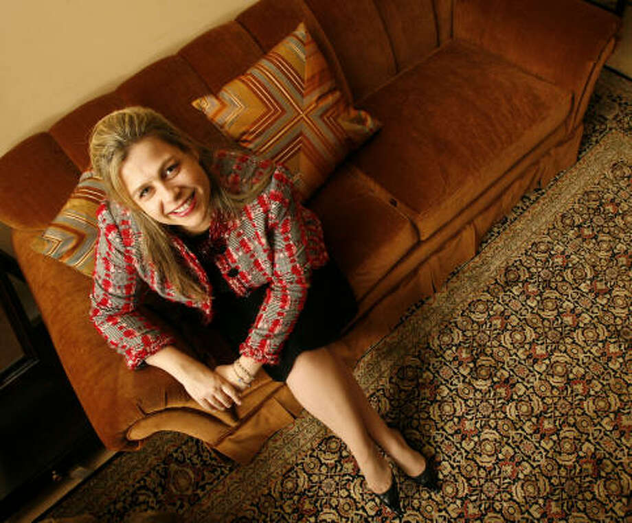 Interior designer Alexa Hampton sits on her Nicholas sofa at Meredith O'Donnell Fine Furniture. Photo: Billy Smith II, CHRONICLE