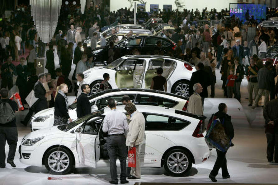 Visitors are seen at the Citroen stand at the Paris Auto Show on Oct. 15, 2008.