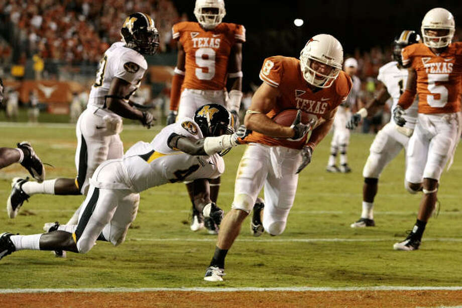 Texas 56, Missouri 31Jordan Shipley leaves Missouri safety Hardy Ricks in the dust on this second-quarter score. Photo: Billy Smith II, Chronicle