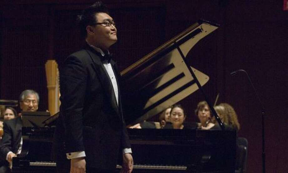 Kwan Yi, winner of the 2007 Ima Hogg Young Artist Competition, will perform with the Houston Symphony on July 8 at Jones Hall. Photo: JEFF FITLOW