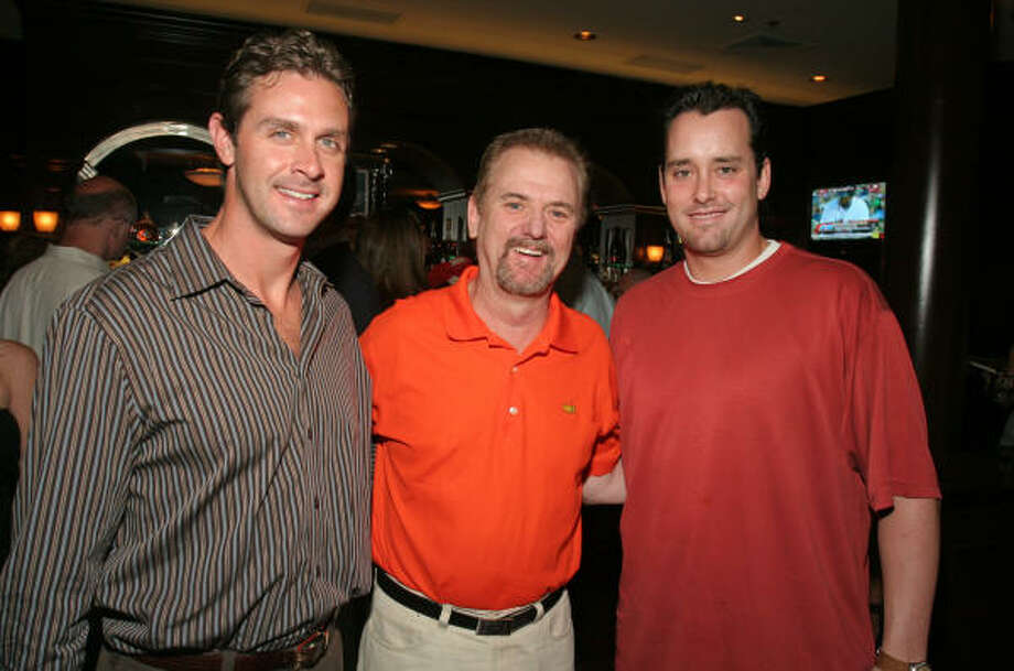 BIG GUNS:Bob's Steak & Chop House owner Ed Toles, center, grabbed a photo op with Astros Trevor Miller, left, and Dan Wheeler at the Astros Wives Black Ties & Baseball Caps underwriter party at Bob's. Photo: Gary Fountain, For The Chronicle