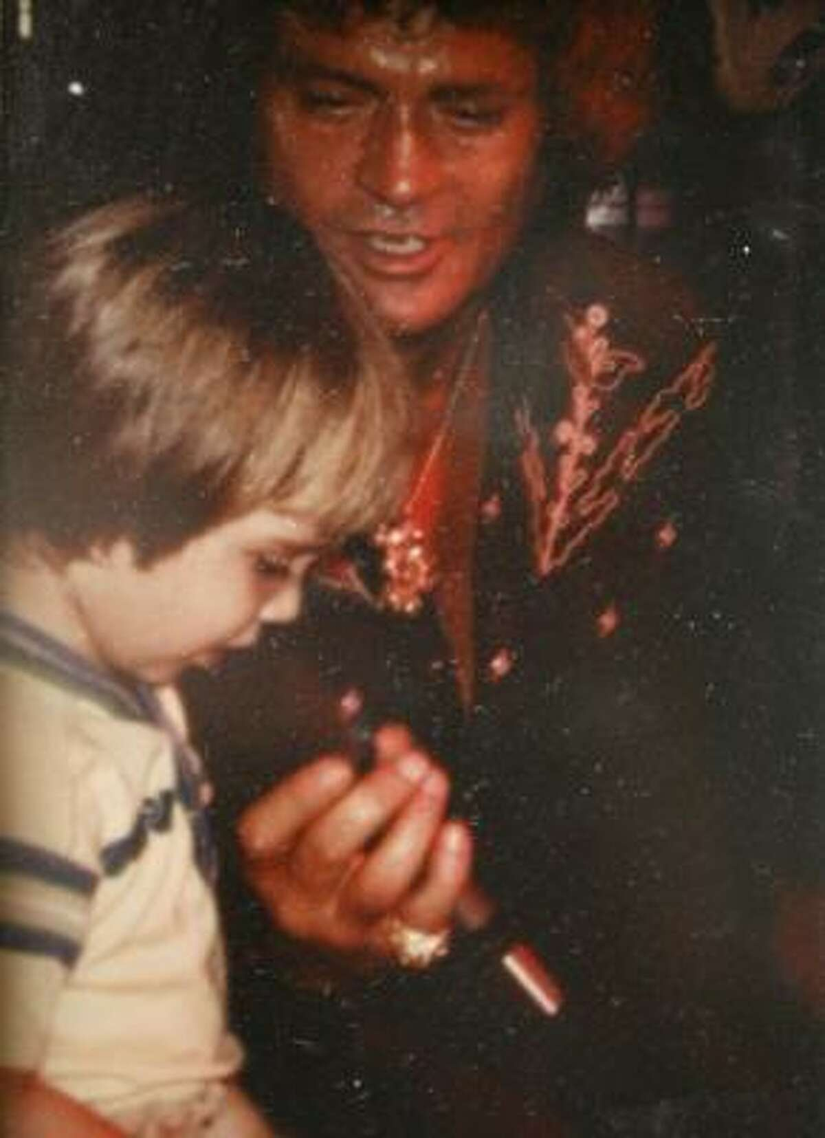 Sundance has joined his father on stage for most of his life. Here, at age 3, he sings with him in Austin.