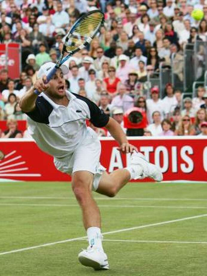 Andy Roddick's run on the grass of Queen's Club includes four tournament titles in five years. Photo: JULIAN FINNEY, GETTY IMAGES