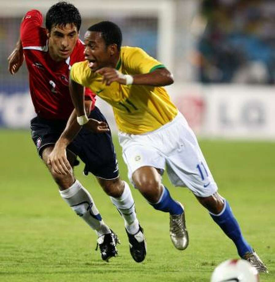 Against Chile, Robinho, right, scored twice as Brazil showed the flair for which it is known. Photo: VANDERLEI ALMEIDA, AFP/GETTY IMAGES