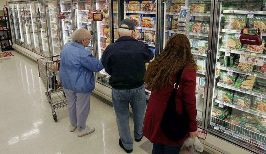Shoppers look through the frozen foods section at the Acme supermarket store in Lawrenceville, N.J. Many U.S. shoppers who are leery of Chinese-made goods and who try to fill their grocery carts with foods free of ingredients from that country may find the task to be difficult. Photo: MEL EVANS, ASSOCIATED PRESS FILE