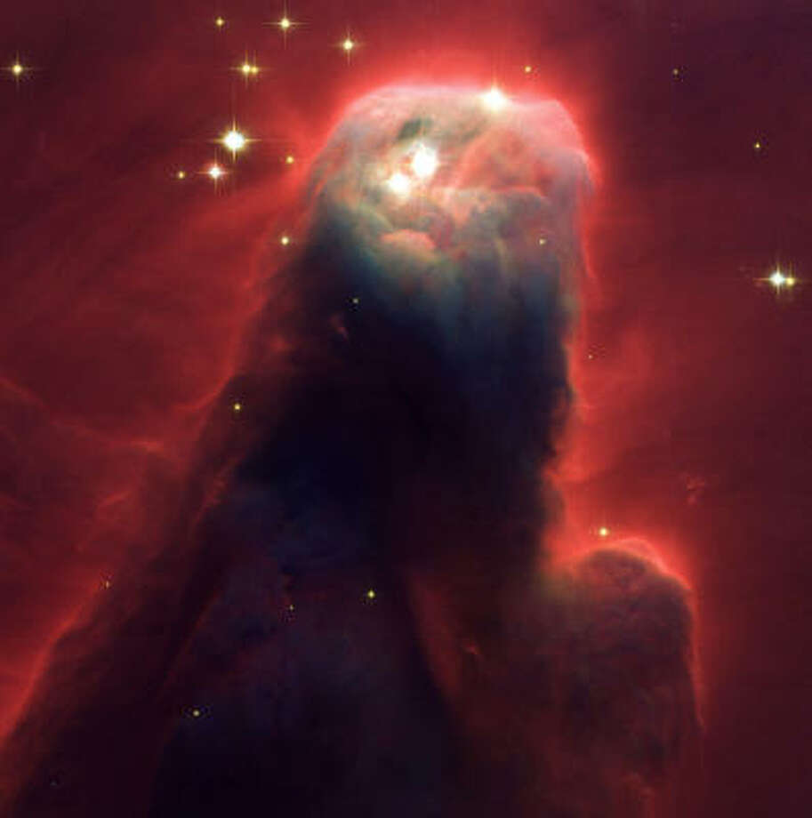 Among the images recorded by the Hubble since its deployment in 1990 is this crimson pillar of gas and dust called the Cone Nebulla (NGC 2264). Photo: AP