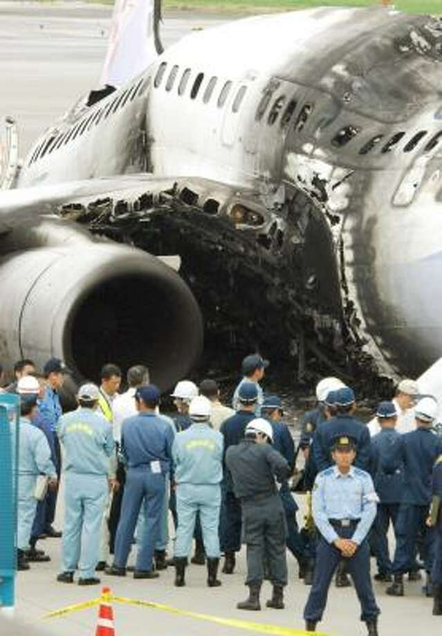 Investigators inspect a burned-out Boeing 737 after it caught fire on the Japanese island of Okinawa last week. Regulators ordered inspections of all 783 newer Boeing 737 planes operating in the U.S. Photo: STR, AFP/GETTY IMAGES