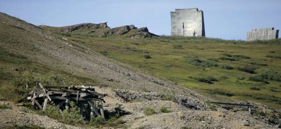 Antennas, upper right, from an abandoned early warning radar site squat on the horizon at Anvil Mountain in Nome. At least 640 contaminated military installations are scattered across Alaska. Photo: AL GRILLO, ASSOCIATED PRESS