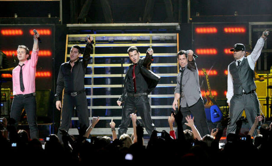 From left, Joey McIntyre, Jonathan Knight, Jordan Knight, Danny Wood and Donnie Wahlberg. Photo: Bill Olive, For The Chronicle