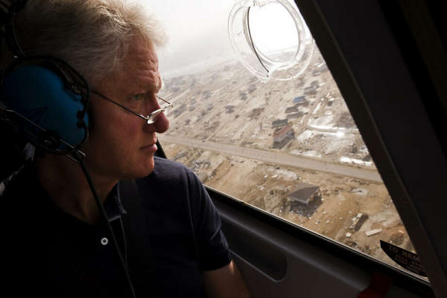 Former President Bill Clinton looks out onto areas of Bolivar Peninsula that were affected by Hurricane Ike. Photo: Smiley N. Pool, Chronicle
