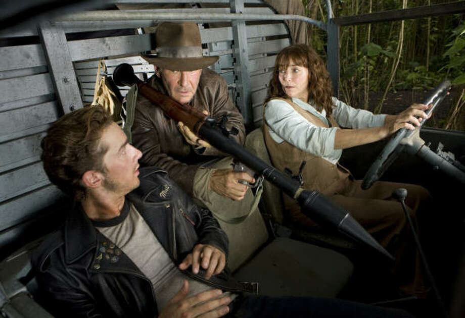 Harrison Ford, center, is back as Indiana Jones, co-starring with Shia LaBeouf as Mutt Williams and Karen Allen as Marion Ravenwood, in Indiana Jones and the Kingdom of the Crystal Skull. Photo: David James, Paramount Pictures
