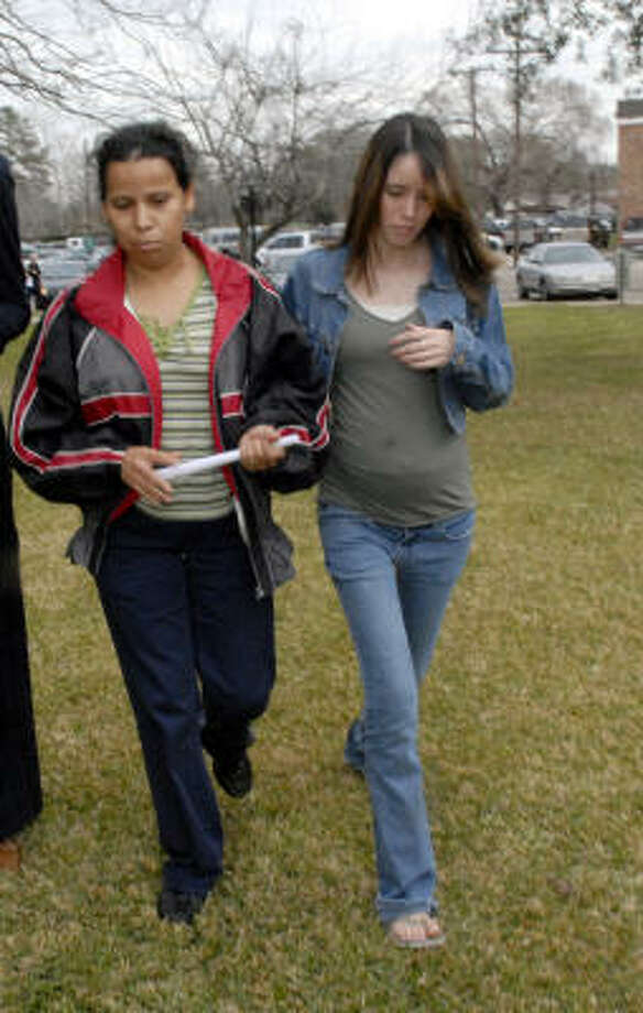 Teresa Miguel, left, and her daughter leave the Brazoria County Courthouse Thursday. Miguel's son is in custody on charges related to a pit bull attack on a cat that was seen in an Internet video. Photo: Kim Christensen, For The Chronicle