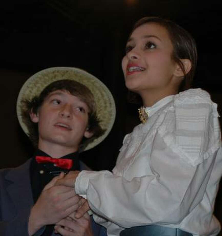 "Harold Hill is played by ninth-grader Tyler Danyla,  and Marion Paroo is played by senior Thara Menon in the matinee performance of Faith West's ""The Music Man."""