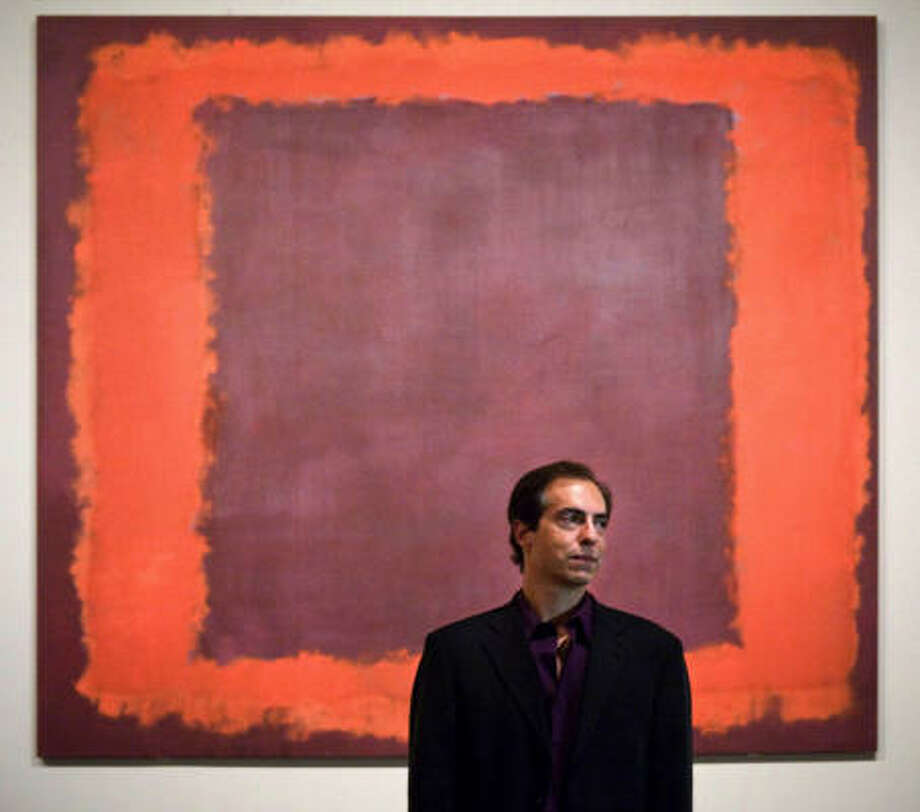 Christopher Rothko stands in front of a piece painted by his father Mark Rothko at the Tate Modern, London. Photo: Sam Drake, AP