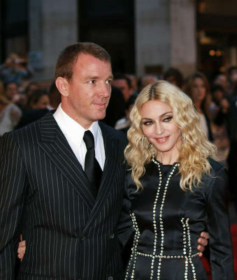 "Madonna arrives with her husband, film director Guy Ritchie, on Sept. 1 for the world premiere of his latest film ""Rocknrolla"", in London's Leicester Square. Photo: MAX NASH, AFP/Getty Images"