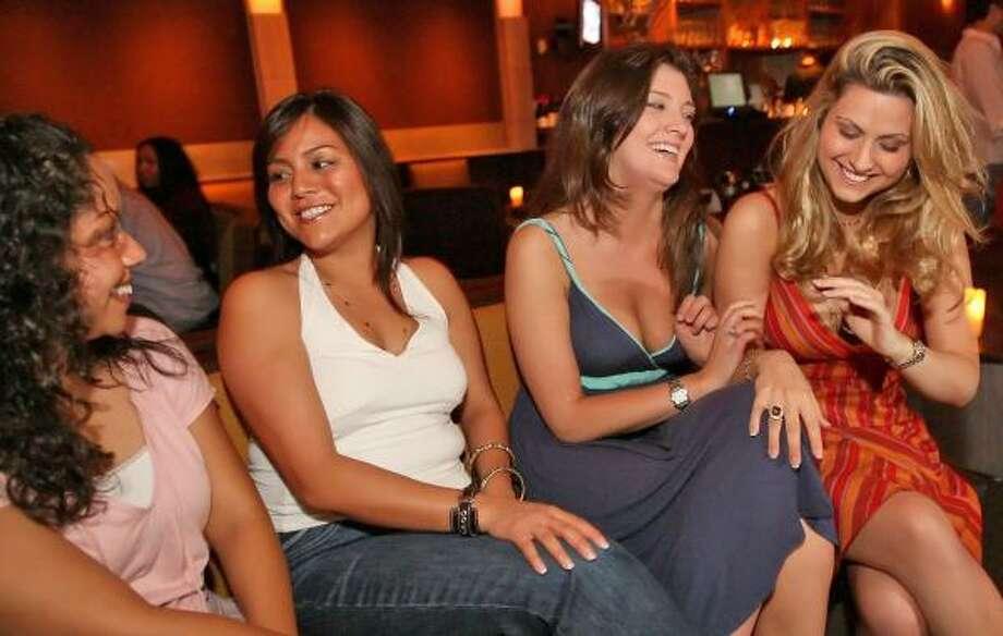 Melissa Espinoza, from left, Nadia Marzuke, Brennan Worthington and Desiree Jones spend an evening enjoying the views at Ibiza. Photo: Bill Olive, For The Chronicle