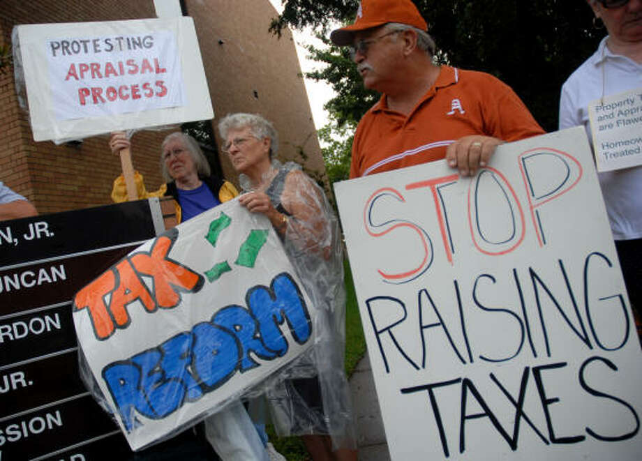 "Members of the Appraisal and Property Tax Legal Reform Group demonstrate in front of the Brazoria County Tax Appraisal District office Monday morning. ""It has just gotten out of hand,'' said Mike Cooper, second from right, who pays about $4,000 a year in property taxes. Photo: Megan True, Chronicle"