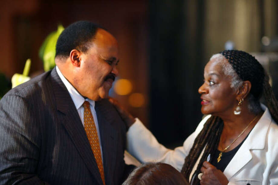 Martin Luther King III smiles with Houston City Council member Ada Edwards on Wednesday at the Martin Luther King Jr. National Memorial Project dream dinner at the Wortham Theater. The dinner raised money for the Martin Luther King Memorial to be built in Washington, D.C. Photo: Steve Ueckert, Chronicle