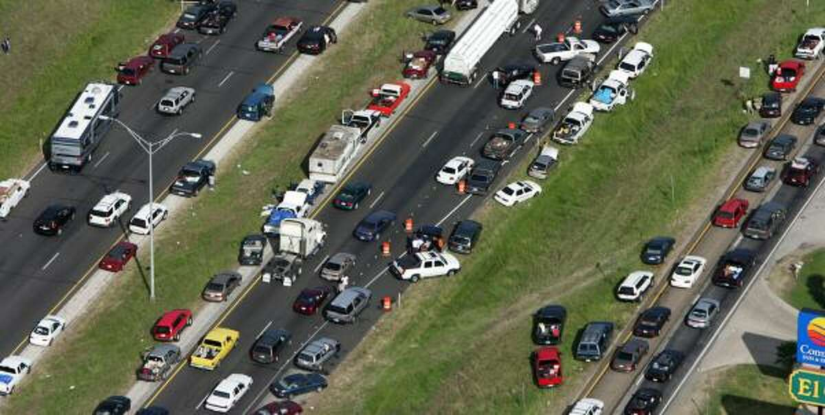 During the evacuation from Hurricane Rita, many vehicles, such as these on the side of Interstate 45 in Huntsville, either broke down or ran out of gasoline.