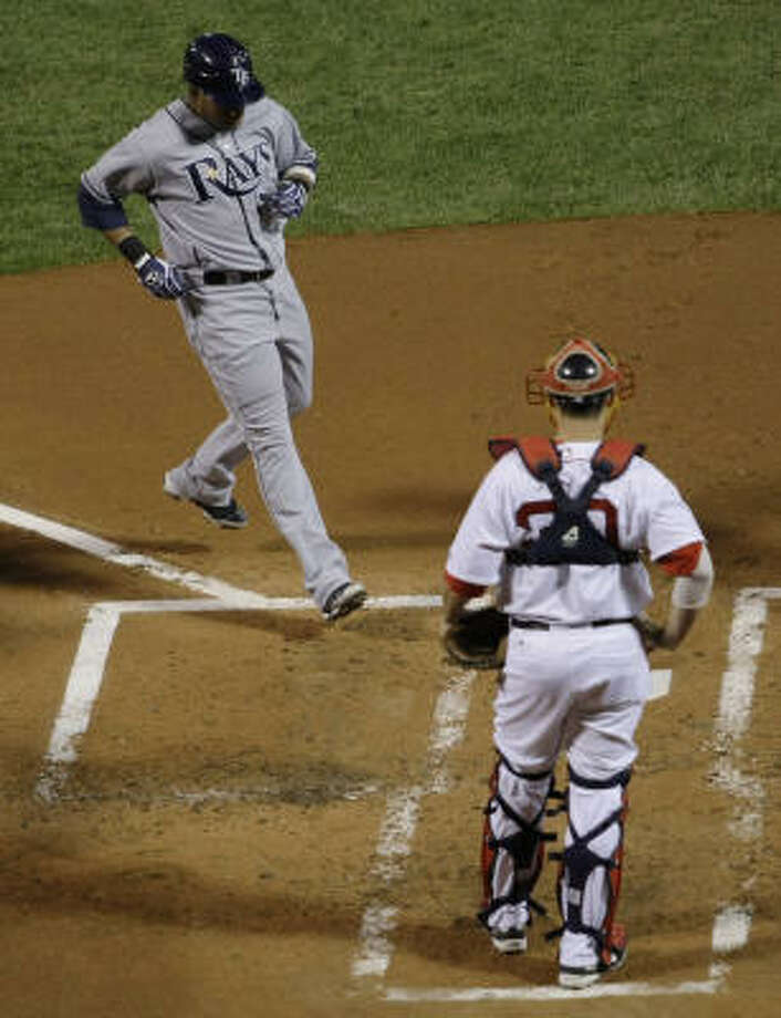 Boston Red Sox catcher Kevin Cash watches has Tampa Bay Rays' Willy Aybar arrives at home plate after hitting a two run home run in the third inning. Photo: Winslow Townson, AP