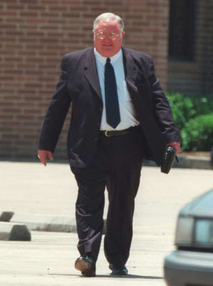 Harris Dempsey 'Butch' Ballow leaves church services at the Abundant Life Christian Center in La Marque, Texas in this file photo from June 2001. Photo: Buster Dean, Chronicle