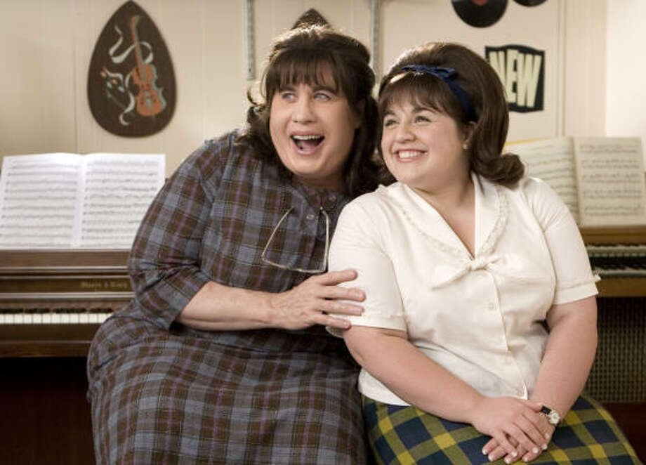 John Travolta, left, and Nikki Blonsky star in Adam Shankman's Hairspray. Shankman stayed true to two traditions: casting an unknown as Tracy Turnblad and casting a man to play Edna, her mother. Photo: David James, New Line Cinema