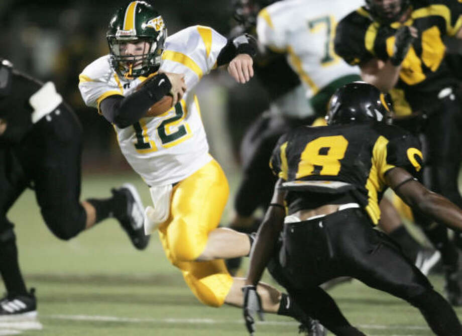 Klein Forest quarterback Ford Lakin keeps the ball and runs for a first down against The Klein Oak Panthers on Oct. 25. Photo: Margaret Bowles, For The Chronicle