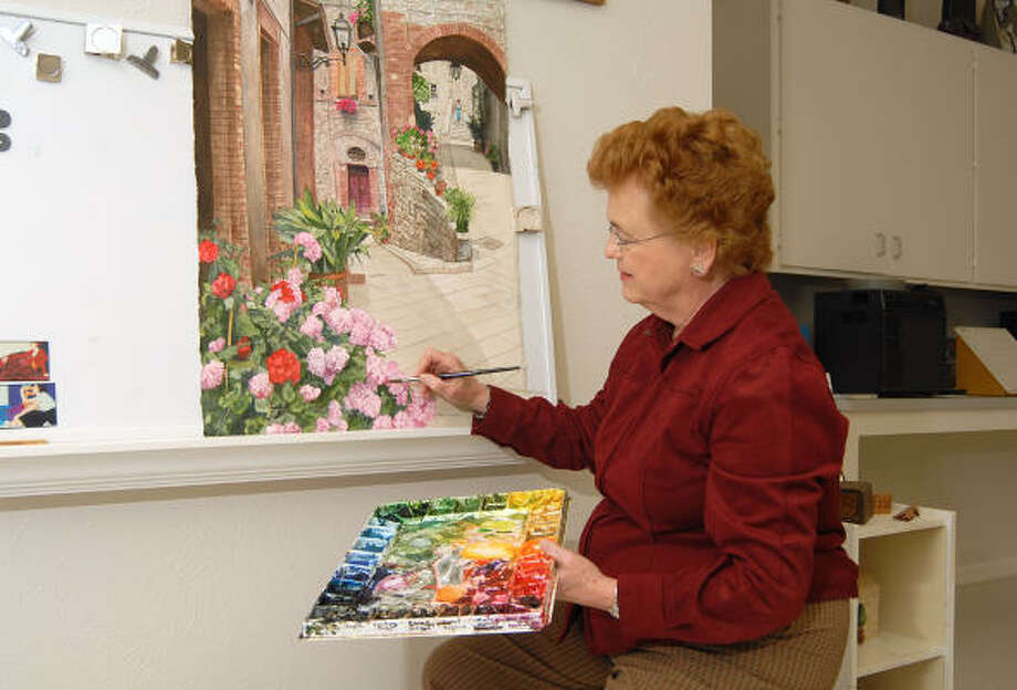 Sylvia Cameron works on a new watercolor painting in her home art studio in The Woodlands. Photo: David Hopper, For The Chronicle
