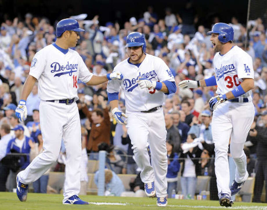 Los Angeles Dodgers' Hiroki Kuroda, left, and Casey Blake, right, celebrate with Russell Martin after Martin and Blake scored on a three rbi triple by Blake DeWitt during the first inning. Photo: Mark J. Terrill, AP