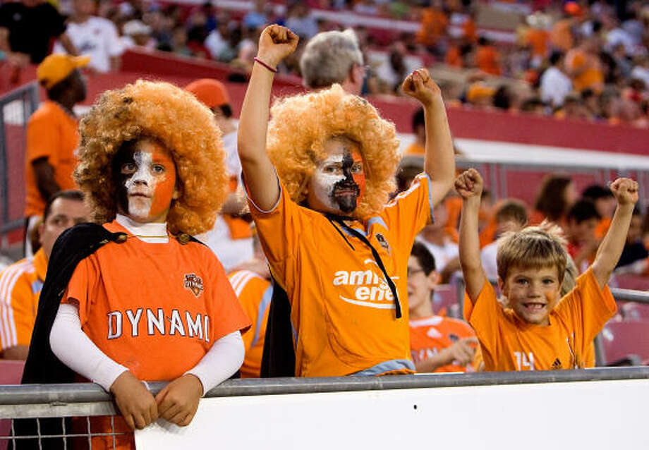 Dynamo fans cheer as the Dynamo hosted D.C. United on Sunday night. Miss any of the action? Get the game statistics here. Photo: Bob Levey, For The Chronicle