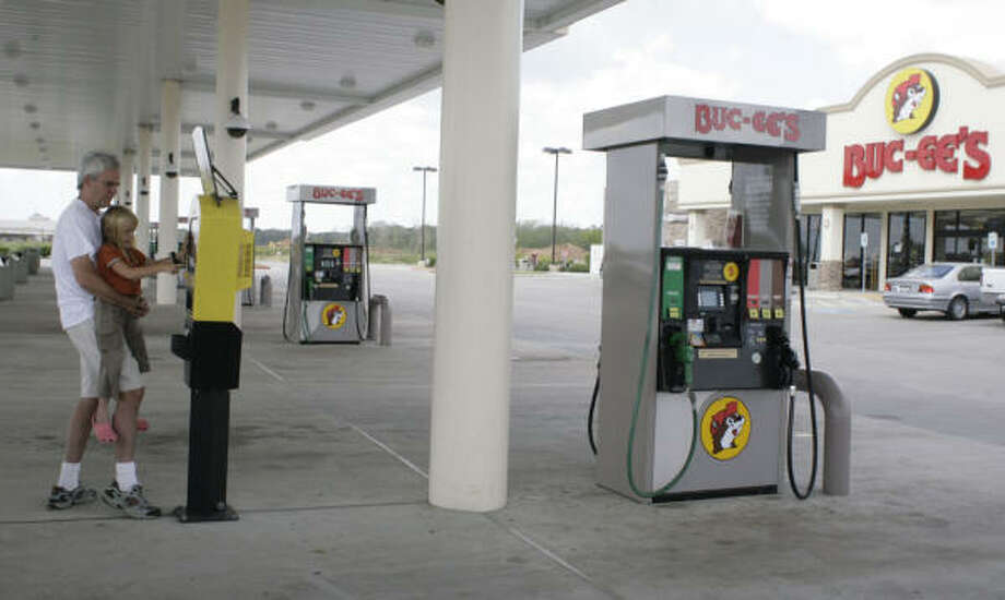 Rows and rows of gas pumps:Although it can get crowded, Buc-ee's has a large number of pumps to keep travelers moving. Photo: Julio Cortez, Chronicle