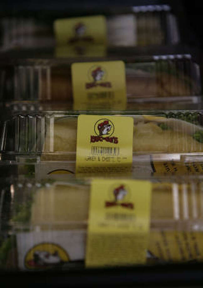 The food:Buc-ee's has an efficient ordering system where customers place their order on a touch-screen computer and then wait for an employee to call it out. You can order deli sandwiches, wraps and other snacks. Photo: Julio Cortez, Chronicle