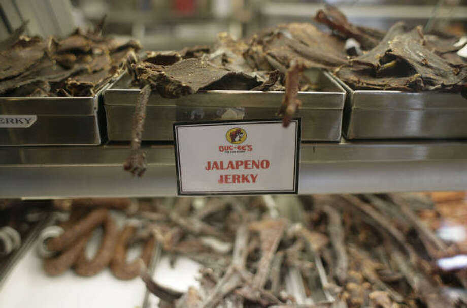 Snacks: The other life-blood of road trips. Each location varies, but some Buc-ee's stores have 100 varieties of wine, potato chips made on site, a Starbucks-like coffee operation, French and Italian olive oils, 48 flavors of Jelly Belly and scores of private-label products, like this jalapeno jerky. Photo: Julio Cortez, Chronicle