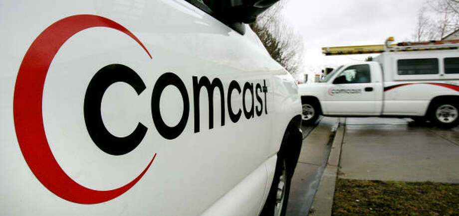 Time Warner will officially become Comcast Cable in the next few months. Photo: Douglas C. Pizac, Associated Press