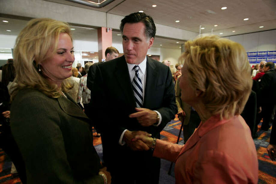 Former Massachusetts Governor Mitt Romney, center, and his wife Ann, left, greet voters gathered for the Republican Party of Iowaís Abraham Lincoln Unity Dinner Saturday in Des Moines, Iowa. Photo: Scott Olson, Getty Images