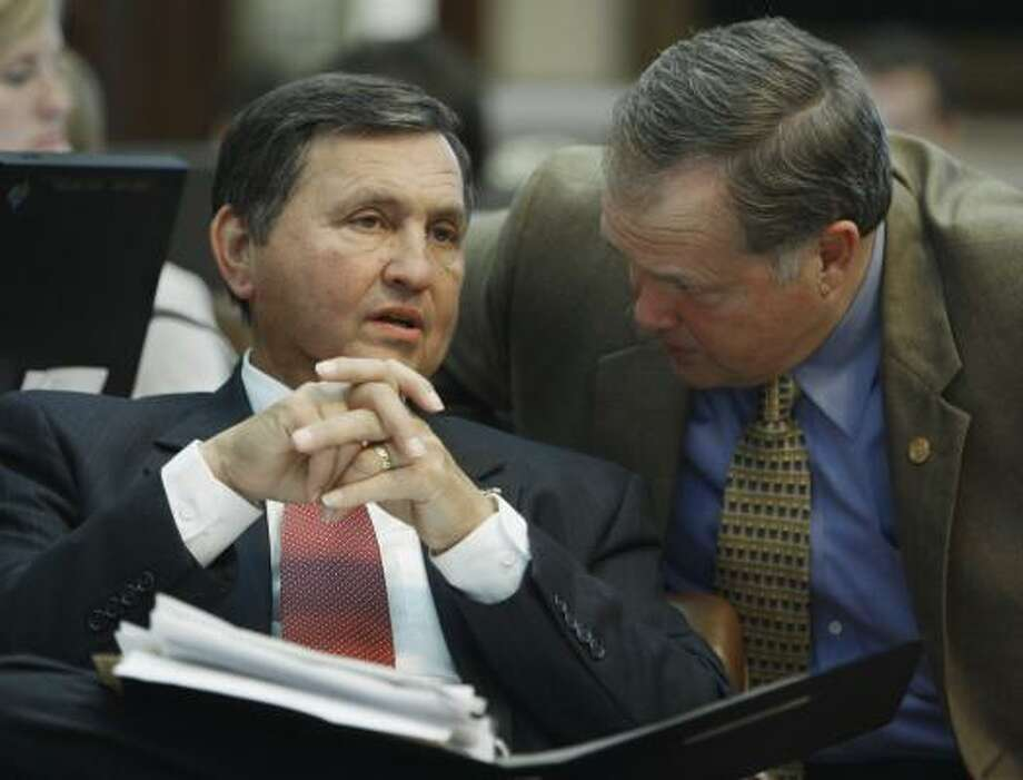 Rep. Charlie Howard, R-Sugar Land, left, talks with Rep. Wayne Christian, R-Center, right, in the House chamber in Austin. Lawmakers debated  Howard's legislation that would encourage schools to adopt policy making it easier for students to voluntarily pray without fear of legal repercussions. Photo: Harry Cabluck, AP