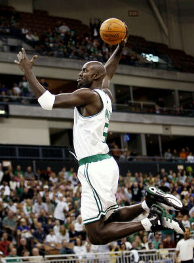 Kevin Garnett soars for a dunk in the first half. Photo: Winslow Townson, AP