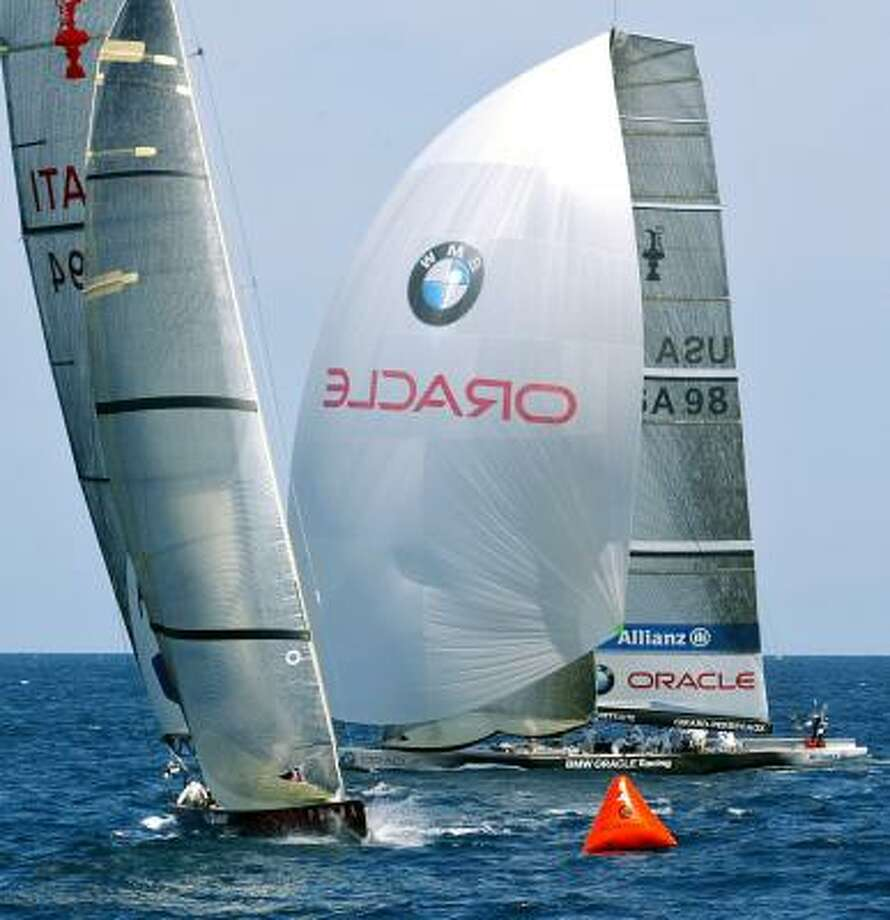 BMW Oracle races against Italian boat Luna Rossa during the second day of the Louis Vuitton Cup semifinals. Photo: JAIME REINA, AFT/GETTY IMAGES