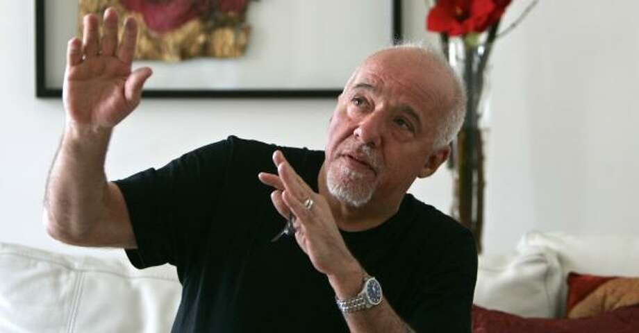 "Brazilian writer Paulo Coelho says he's drawn to the ascetic life, following pilgrimage routes or wandering in the Mojave desert, yet he's an Internet addict who's in ""withdrawal"" without his computer. Photo: FRANCOIS MORI, ASSOCIATED PRESS"