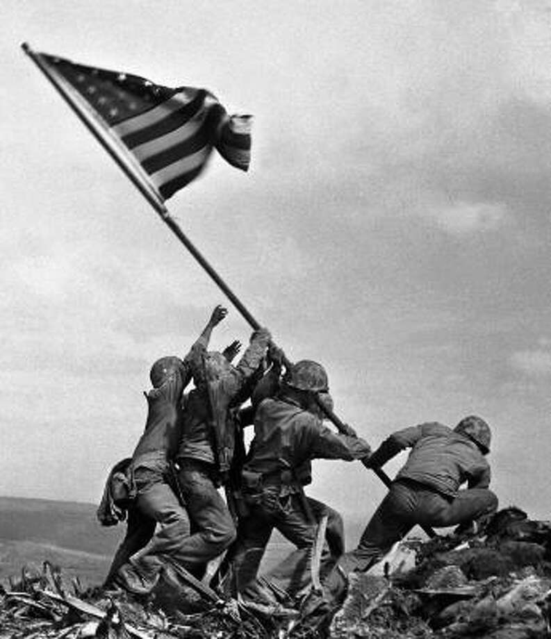 The famous photograph by Joe Rosenthal of The Associated Press showing Marines raising the American flag on Mount Suribachi. Photo: Joe Rosenthal, AP