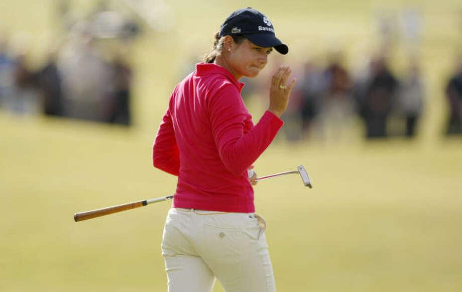 Lorena Ochoa waves to the gallery during Saturday's third round of the Women's British Open. Photo: MATT DUNHAM, AP