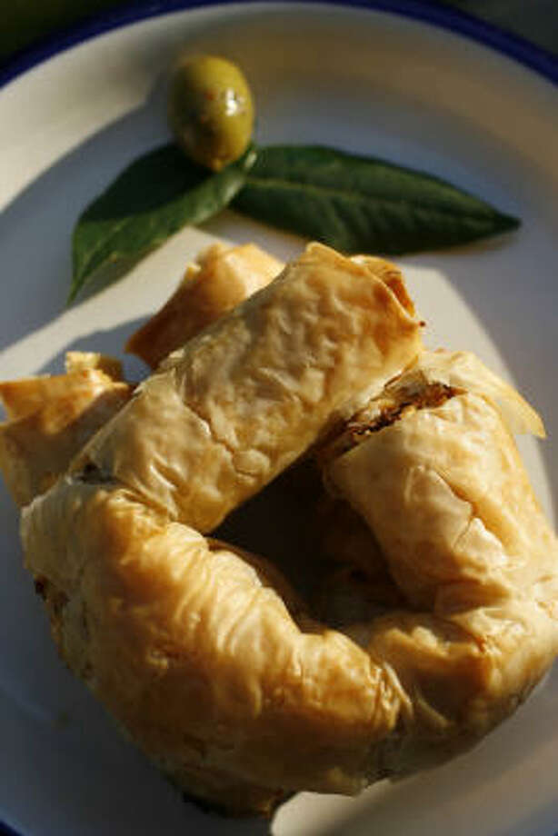 ROLL, ROLL, ROLL YOUR DOUGH: Phyllo coils are filled with tomatoes, fennel and feta. Photo: Karen Warren, Chronicle