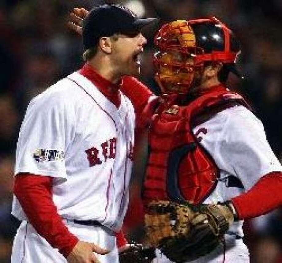 Just like in 2004, Jason Varitek (right) and the Red Sox have a 2-0 lead in the World Series. Photo: Elsa, Getty Images