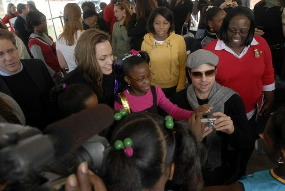 Angelina Jolie and Brad Pitt meet Saturday with families in New Orleans affected by Hurricane Katrina. Photo: CHERYL GERBER, ASSOCIATED PRESS